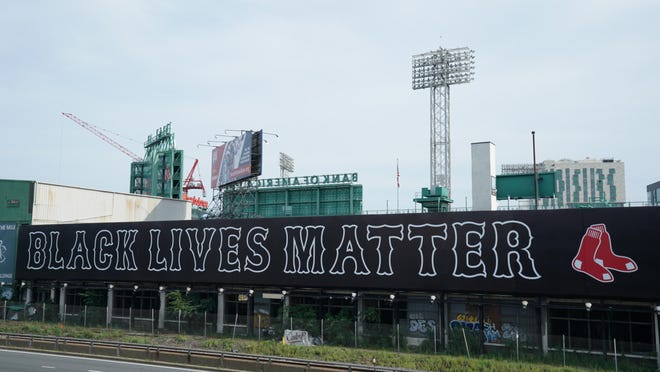 A Black Lives Matter sign hangs outside Fenway Park on Opening Day against the Baltimore Orioles.