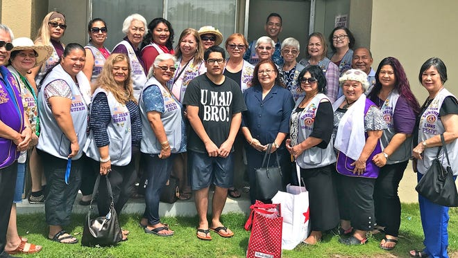 """Guam Sunshine Lions Club members visited Jesusa Cruz, 85, of Ipan, Talofofo, on April 14 as a continuing community service activity in its goal of """"Caring for the Sick and the Elderly."""" Members brought supplies, song, and cheer to the elderly resident.  Shown front row from left: Lions Danny Cruz, Clare Cruz, Mariana Guzman, LouJean Borja, and Helen Colby; Kevin Cruz, (grandson, who received donation on behalf of Cruz); Lions Flo Terlaje, Connie Rivera, Ewy Taitano, Pete Babauta, Julie Garcia, and Marietta Camacho. Second row from left: Lions Sophie Losongco, Tish Tano, Lola Flores, Lorraine Rivera, Clarice Quichocho, Bobbie Flores, Jill Pangelinan, Helen Mendiola, Frank B. Aguon, Jr., Jovie Mejorada, Julie Cruz, and Doris Limtiaco."""
