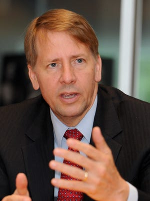 Richard Cordray, director of the Consumer Financial Protection Bureau, speaks with USA TODAY's editorial board members.