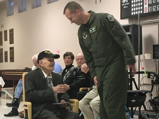 File: Col. Ty Neuman, commander of the 2nd Bomb Wing, Barksdale Air Force Base, greets Cpl. Olan Wise at his 100th birthday party in February.
