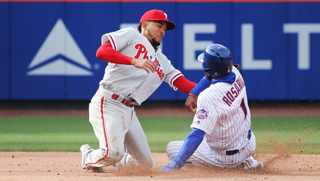 New York Mets shortstop Amed Rosario (1) is tagged out by Philadelphia Phillies shortstop J.P. Crawford (2) after attempting to steal second base during the fourth inning at Citi Field.