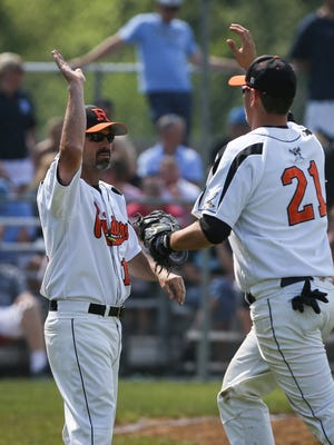 Ryle head coach Pat Roesel high fives Zach Mann following Ryle's 5-1 win over Boone County Sunday, May 22, 2016.