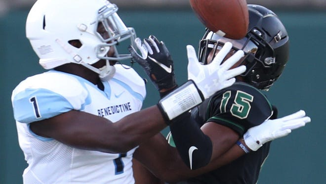 Benedictine's Christopher Gales and St. Vincent-St. Mary's   Shawntel Lodge vie for the ball during the Bengals' Week 2 win on Friday Sept. 4, 2020.