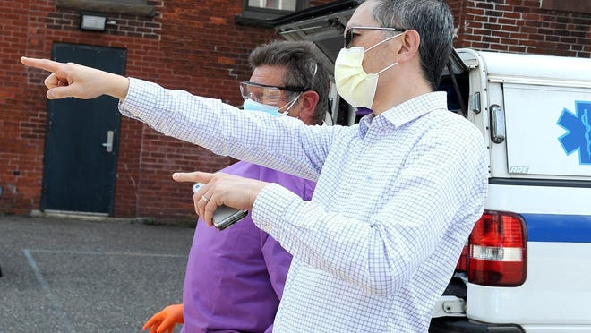 """Framingham Director of Public Health Director Sam Wong, shown earlier this year at a coronavirus testing site, said ongoing household transmission has him on edge with the holiday season coming. """"I'm afraid people from different households will get together and that is concerning,"""" he said."""