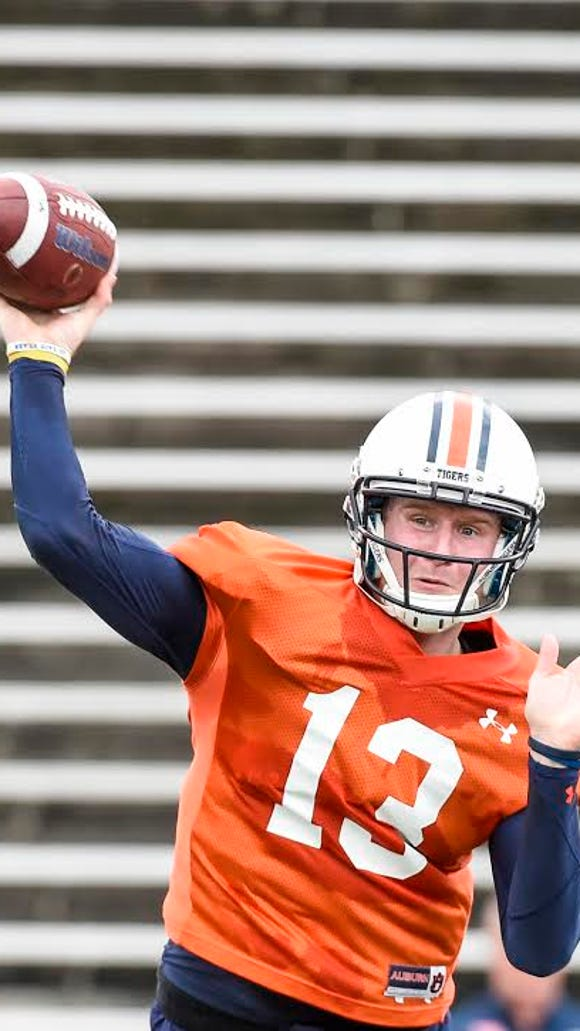 Auburn quarterback Sean White throwing a pass during practice at Hoover High School Sunday morning.