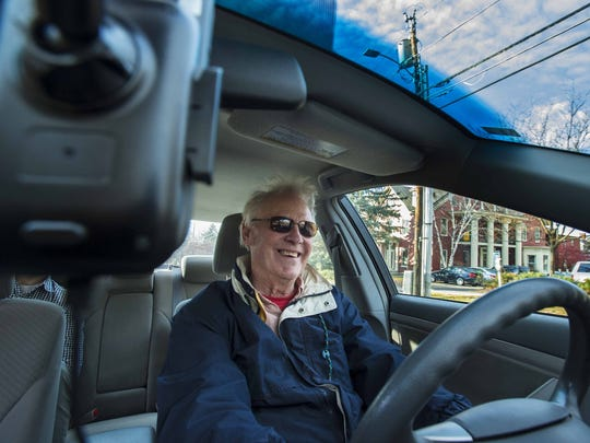 Uber driver John Hodgson ferries passengers in Burlington on Wednesday, November 11, 2015.