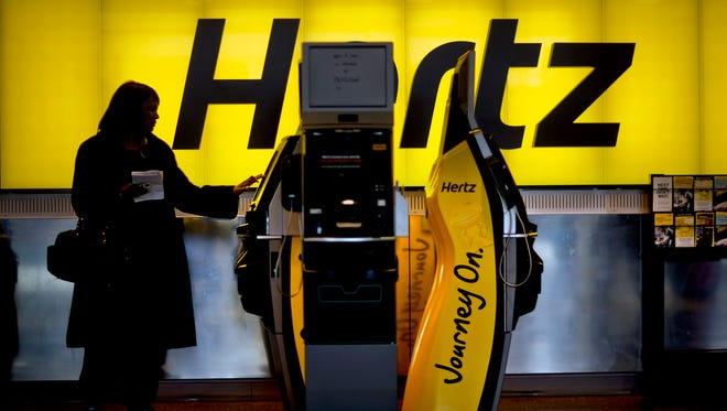 Consumer watchdogs warn that consumers need to gas up before returning vehicles, return a car in time to avoid late charges and think twice about returning and leaving a car in a rental lot after hours. A customer checks in at a Hertz car rental counter in Atlanta.