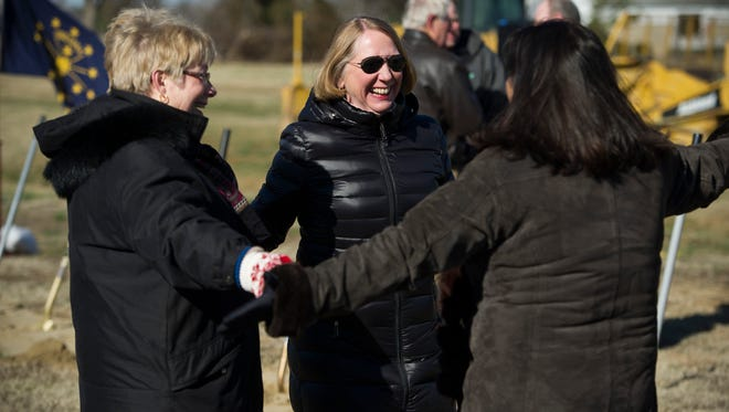 Jane Shafer Jackson, from left, Cindy Brinker, and, Gayle Rogers, all of Evansville, greet each other during a groundbreaking ceremony for the new McCutchanville Elementary, just north of McCutchanville Park on Petersburg Road, Saturday, Feb. 4, 2017. All three attended the original McCutchanville school.