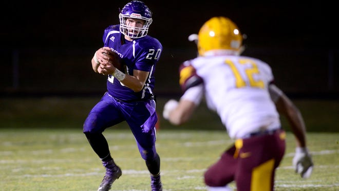 Mitchell junior Ben Robinson became a 1,000-yard rusher for the first time in his varsity football career Friday night.