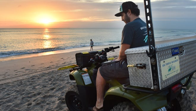 "Joseph Scarola, a sea turtle biologist with Ecological Associates in Jensen Beach, stops at Waveland Beach in St Lucie County on Monday, March 12, 2018, while looking for sea turtle nests between Jensen Beach in Martin County and Normandy Beach in St. Lucie County. Scarola patrols the beaches every morning at sunrise seven days a week to document turtle nests, but no new nests were found on Monday. ""I've really felt the need that we need to protect these majestic animals and it's something that I want my kids to see in the future, so without these protections they won't be here in the future,""  Scarola said about the future of sea turtles."