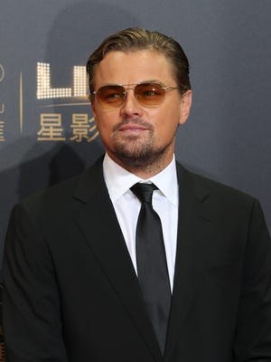 Leonardo DiCaprio poses at the red carpet of the opening ceremony for the Studio City project in Macau, Tuesday, Oct. 27, 2015. (AP Photo/Kin Cheung)