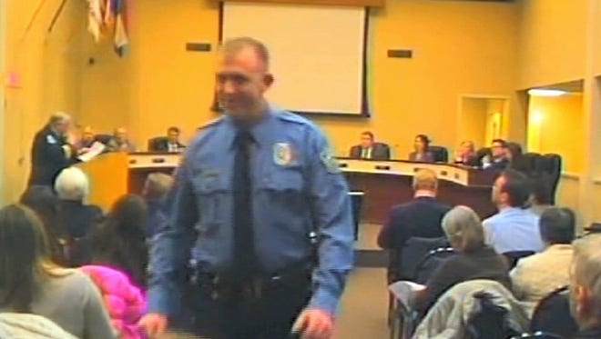 An image from video released by the City of Ferguson, Mo., in which officer Darren Wilson attends a city council meeting in Ferguson.