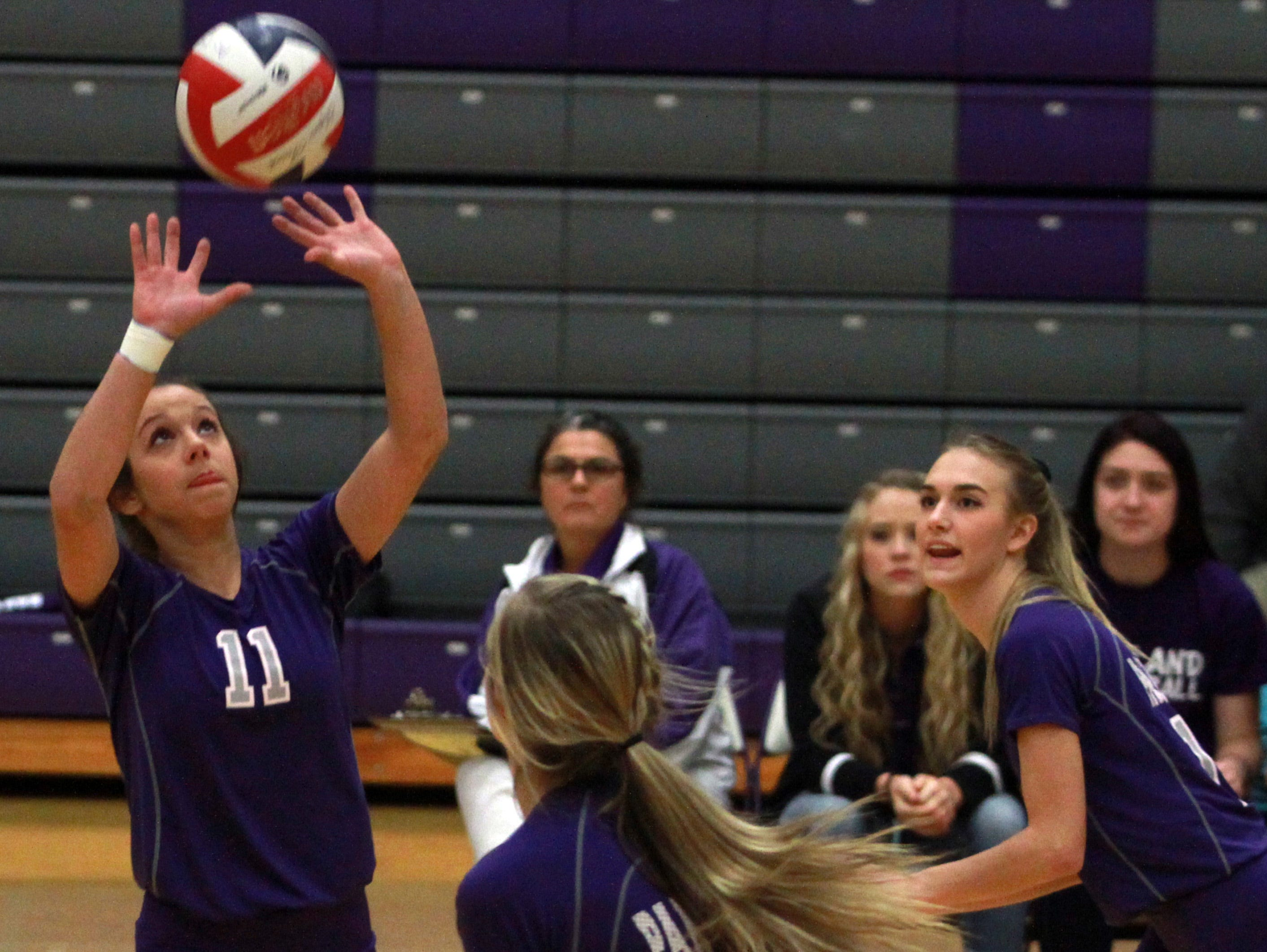 Portland's Rachel Jennings sets a ball for her teammates during Thursday's Class AAA sectional match against Ravenwood.