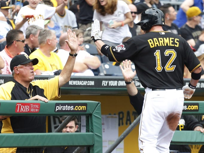 Pittsburgh Pirates manager Clint Hurdle (13) greets Pirates shortstop Clint Barmes (12) after Barmes scored a run on a balk call against Cincinnati Reds starting pitcher Homer Bailey (not pictured) during the fifth inning at PNC Park.
