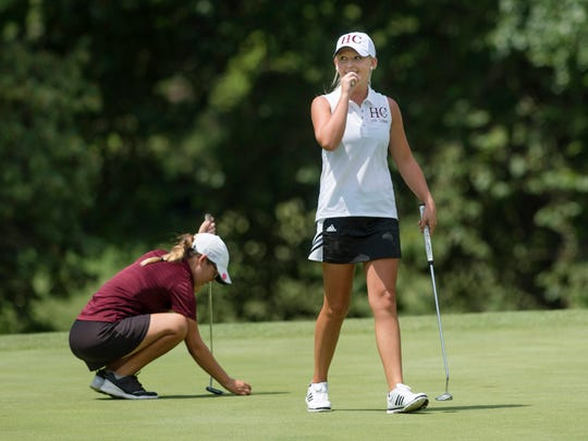 Henderson County's Payton Carter, right, looks to her coach after making par on the second playoff hole during the Henderson County Invitational at the Henderson County Country Club July 31, 2017.