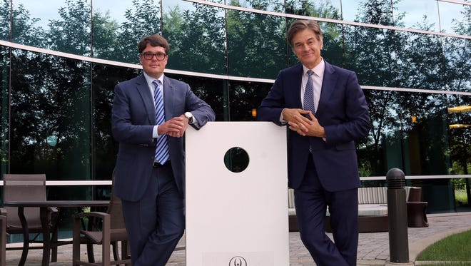 Sharecare founders Jeff Arnold, left, and Dr. Mehmet Oz stand with a Healthways-branded cornhole board at Healthways' headquarters in Franklin on Wednesday, Aug. 17, 2016.