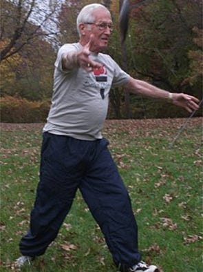 Rev. Champion Goldy has taken up javelin and discus. He will play in Senior Olympic. Demonstrating how he throws the discus. (photo by Velvet McNeil 11.9.00)