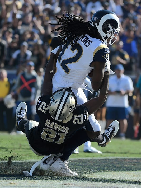 Los Angeles Rams wide receiver Sammy Watkins, scores over New Orleans Saints cornerback De'Vante Harris during the first half of an NFL football game, Sunday, Nov. 26, 2017, in Los Angeles. (AP Photo/Kelvin Kuo)