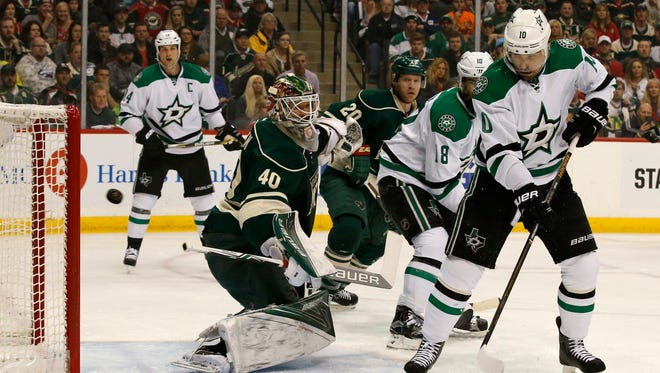 Dallas Stars left wing Patrick Sharp (10)  watches as a shot by Stars defenseman John Klingberg gets past Minnesota Wild goalie Devan Dubnyk (40) for a goal during the first period of Game 6 in the first round of the NHL Stanley Cup playoffs in St. Paul, Minn., Sunday, April 24, 2016. (AP Photo/Ann Heisenfelt)