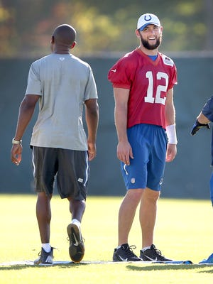 Colts quarterback Andrew Luck (12) shares a laugh with offensive coordinator Pep Hamilton,left, during practice Oct. 5, 2015, at the Colts Complex on West 56th Street.
