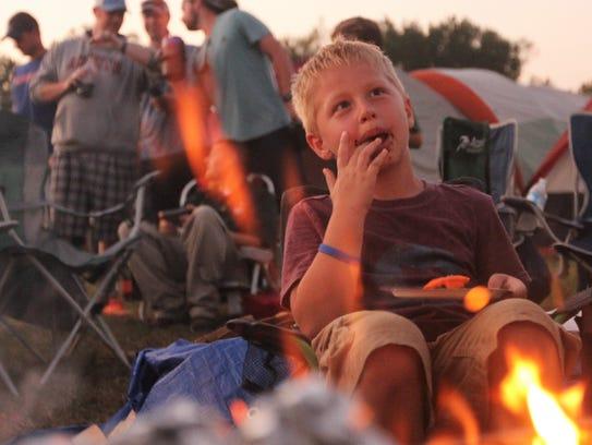 John Beheler, 6, eats a smore.