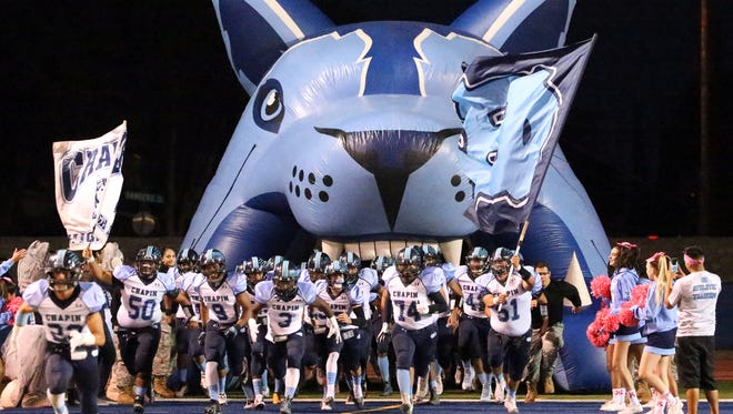 The Chapin Huskies take the field against the Irvin Rockets during their District 1-5A showdown Friday night at Irvin.  See more photos at elpasotimes.com.