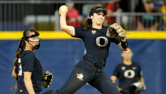 Oregon's Lauren Lindvall (8) throws back to first but