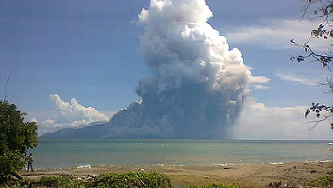 The photo taken from the Maurole district of East Nusa Tenggara province with a camera phone shows Mount Rokatenda volcano spewing a huge column of hot ash during an eruption Saturday.