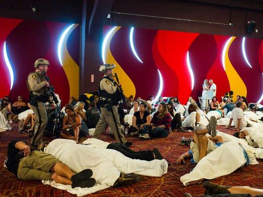 Las Vegas police sweep through a convention center