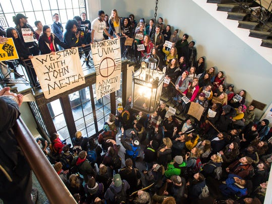 Ebony Nyoni, top left, co-founder of Black Lives Matter Vermont, speaks during a rally held by NoNames For Justice at the University of Vermont in Burlington on Tuesday, February 20, 2018, at which members of the organization called for the resignation of UVM president Tom Sullivan and other top administrators.