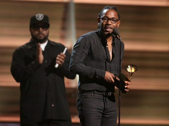"""Kendrick Lamar accepts the award for best rap album for """"To Pimp A Butterfly"""" at the 58th annual Grammy Awards Feb. 15, 2016, in Los Angeles."""