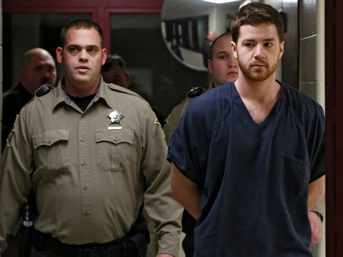 Cody M. Cousins, 23, walks to his initial hearing at the Tippecanoe County Jail in Lafayette Thursday, Jan. 23, 2014. He is charged with murder in the shooting and stabbing death of engineering student Andrew Boldt on the campus of Purdue University.