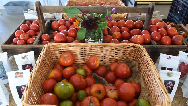 Organic tomatoes are pictured on display inside the farm stand at Obercreek Farm in Hughsonville on Aug. 3.