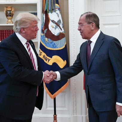 President Trump shakes hands with Russian Foreign Minister