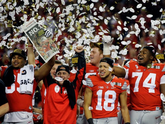 Ohio State players celebrate after winning the national championship against Oregon on Monday night in Arlington, Texas.
