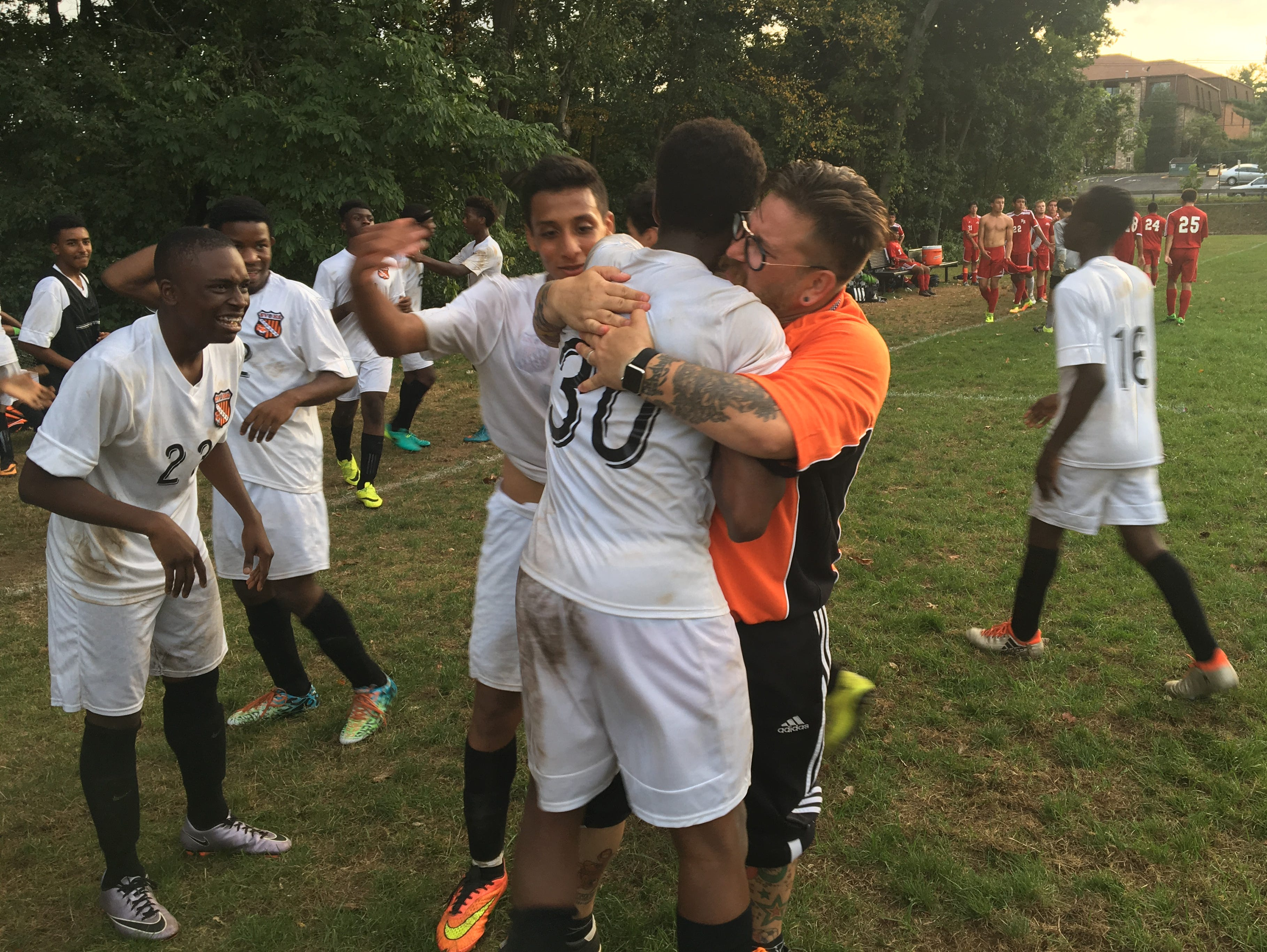 Spring Valley boys soccer head coach Ryan Marcus hugs Alexander Taylor after scoring the game-winning goal in a 1-0 double-overtime win over North Rockland. Sept. 20, 2016.