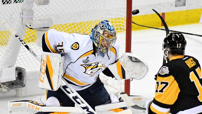 Pittsburgh Penguins right wing Bryan Rust (17) scores on Nashville Predators goalie Pekka Rinne (35) during the first period of game 5 of the Stanley Cup Final at PPG Paints Arena Thursday, June 8, 2017, in Pittsburgh, Pa.