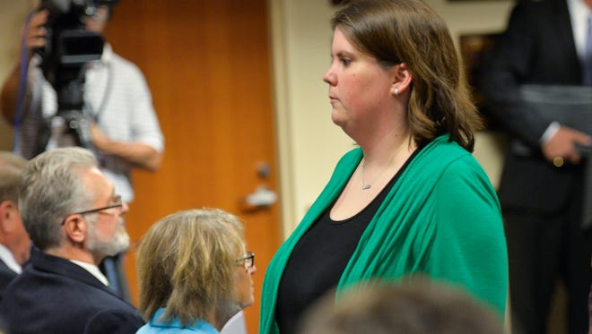 Alison Feigh walks past Jerry and Patty Wetterling and into the press conference Tuesday, Sept 6 that followed a federal court hearing related to the Jacob Wetterling case.