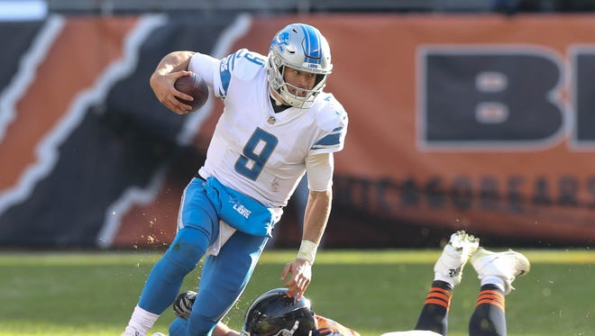 Matthew Stafford is tripped up by the Chicago Bears' Mitch Unrein in the third quarter of the Detroit Lions' 27-24 win Sunday, Nov. 19, 2017 at Soldier Field in Chicago.