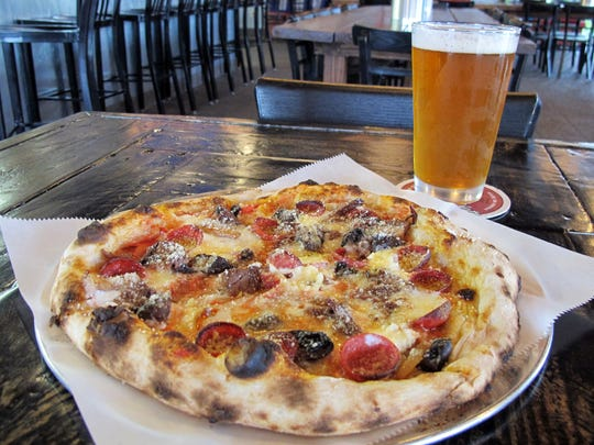 The Pepper-Bro-Ni pizza includes smoked brisket, pepperoni, ricotta, garlic, mushrooms and charred onion at LowBrow Pizza & Beer, 3148 U.S. 41 E., East Naples.