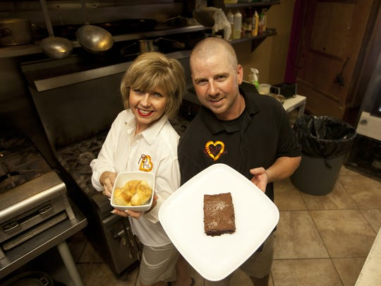 Arvey Krise, left, and her son Reuben Sliva own Reuben's Smokehouse in Fort Myers. The travel site TripAdvisor named the restaurant among the best barbecue joints in the country Wednesday.