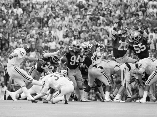 FILE - In this Sept. 24, 1977, file photo, Oklahoma's Uwe von Schamann kicks a field goal past Ohio State defenders Kelton Dansler (32), David Adkins (94) and Eddie Beamon (67) in the closing seconds to give Oklahoma a 29-28 win in an NCAA college football game in Columbus, Ohio. Oklahoma's Bud Herbert (33) watches the kick. The teams meet in Columbus this week for the first time since that game. (AP Photo, File)