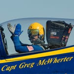 In this Sept. 10, 2011 photo provided by the U.S. Navy, Capt. Greg McWherter, commanding officer and flight leader of the U.S. Navy flight demonstration squadron, the Blue Angels, responds to the crowd at the Guardians of Freedom Air Show in Lincoln, Neb.