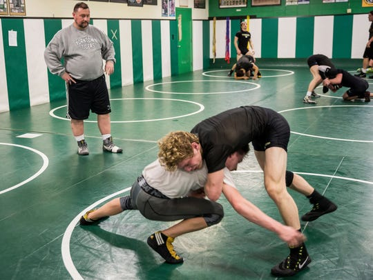 Trent McCormick works with his wrestlers for the final