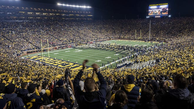 An overview of fans cheering as the Michigan football team takes to the field in Michigan Stadium before an NCAA college football game against Wisconsin in Ann Arbor, Mich., Saturday, Oct. 13, 2018.