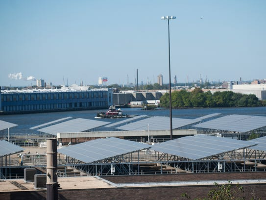 Solar panels are seen from the rooftop of the Camden