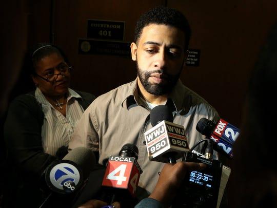 Austin Williams, 28, speaks to the media outside of