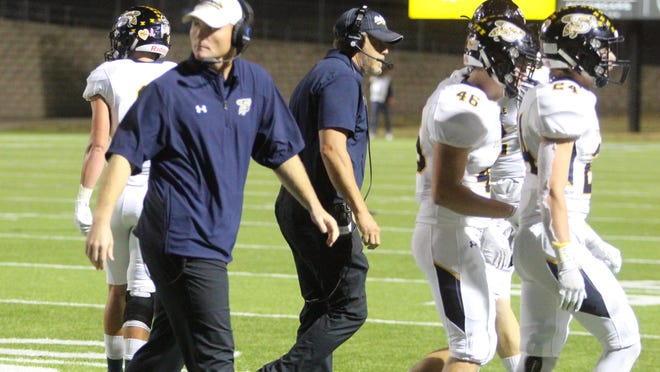 Sterling Doty (left) is entering his second season as head coach of the Stephenville High School Yellow Jackets, who are picked as the No. 11 Class 4A Division I football team in the state in Dave Campbell's Texas Football preseason predictions for 2020.