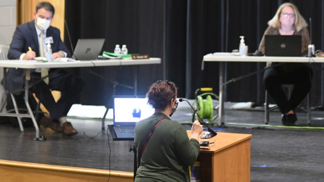 In this June 2020 file photo, Pender County school board members listen to a public comment period during a meeting at Topsail High School. The school board is facing a lawsuit after a teacher was allegedly attacked by a student in April 2018.