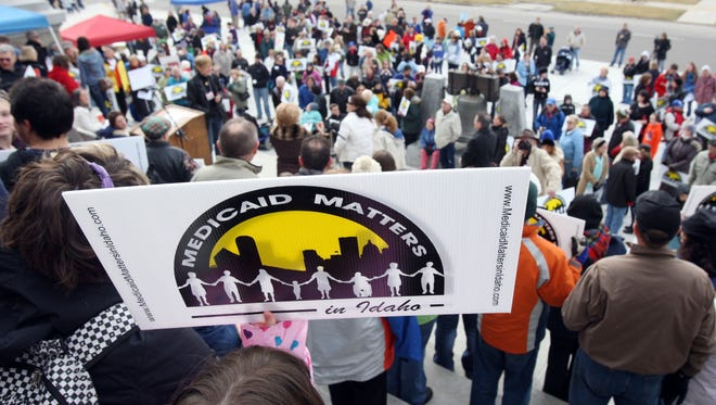 Idaho residents protested proposed Medicaid cuts outside the Statehouse in Boise in 2011.